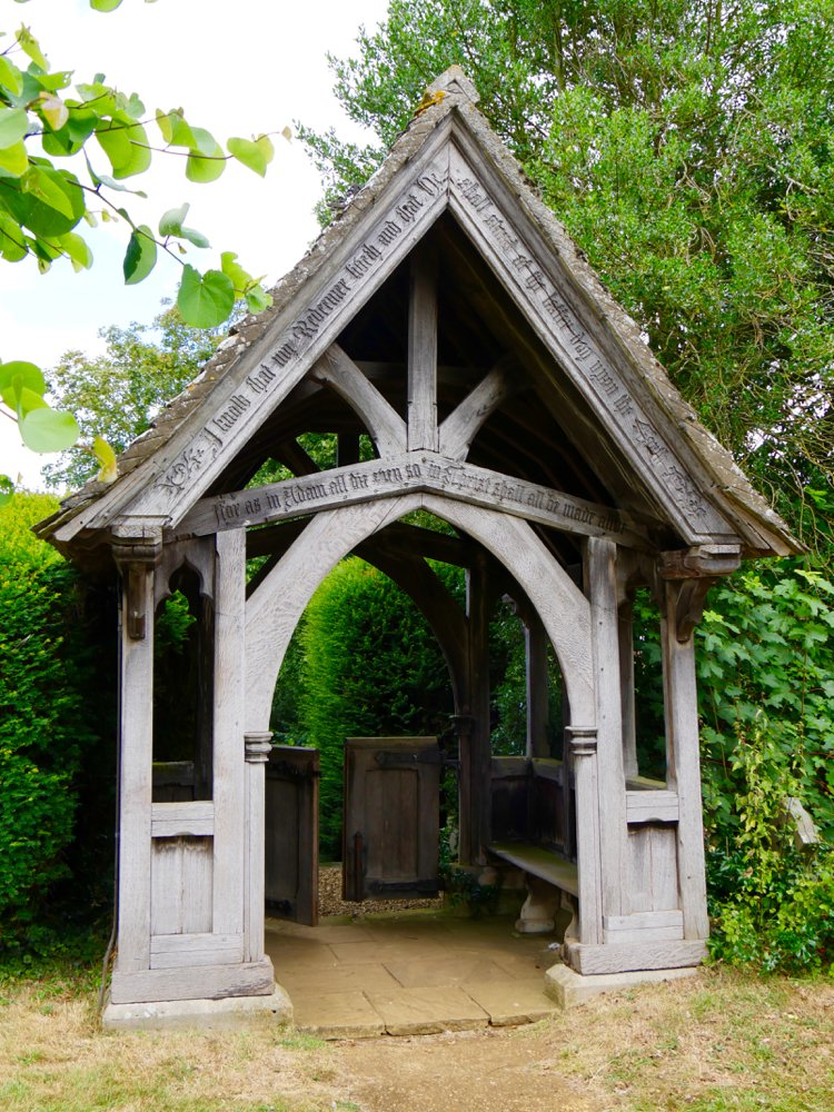 The church lychgate built from oak with a little chestnut here and there and then topped with stone roofing.