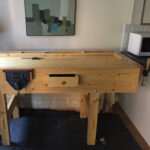 Francois Lafaix- This workbench is made out of red wood (pinus sylvestris) and follows very closely the methods and dimensions of the 2017/18 video series, customisations included, but the right legs have been moved 7 inches to the left to accommodate a tail vise and its hard maple jaws which I salvaged from another workbench. The front vice (the only vice I've used so far) is a Record 52 1/2E from ebay. The drawer handle is a modified B&Q beech handle, and the casters are Powertec 17000 from Amazon.com. Overall, I couldn't wish for a better workbench, and hand tool initiation, but may add some benchdogs to make it even more practical.